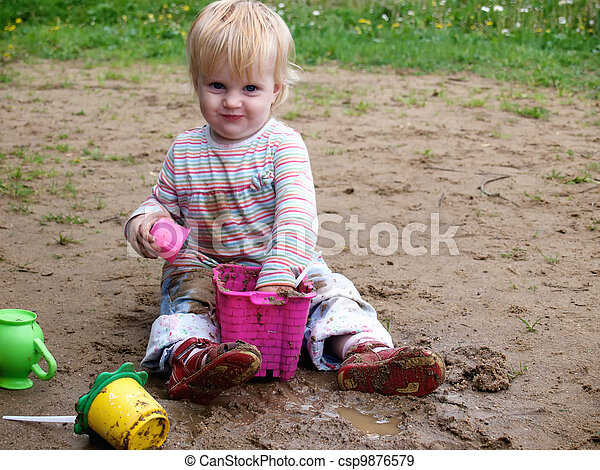 Dirty baby play with sand - csp9876579