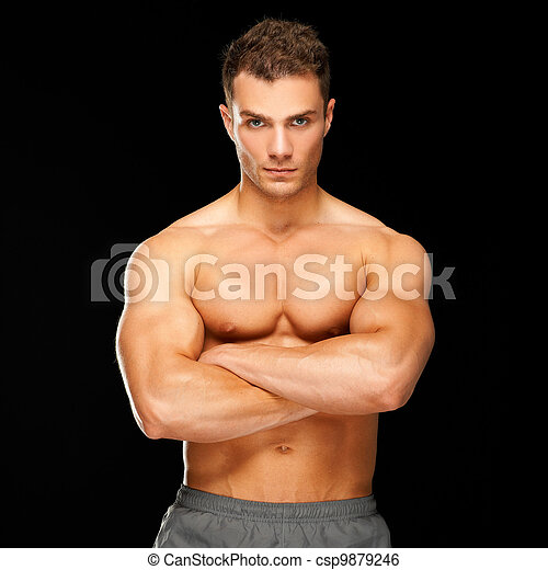 Handsome man with arms crossed looking his left on black - csp9879246