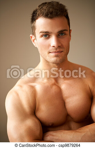 Close up of sporty man with muscular arms crossed - csp9879264