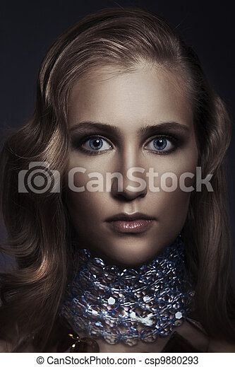 Beautiful woman with evening make-up. Jewelry and Beauty. Fashion photo - csp9880293