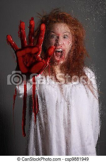 Horror Themed Image With Bleeding Frightened Woman - csp9881949