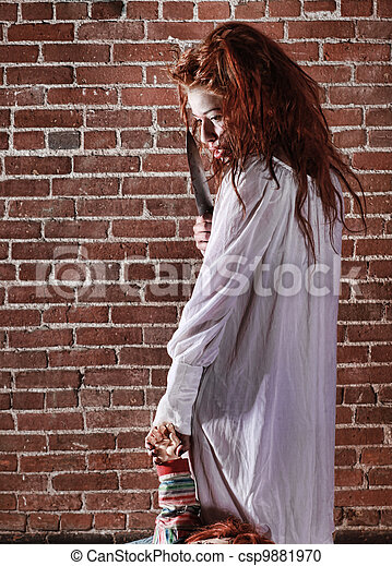 Horror Themed Image With Bleeding Frightened Woman - csp9881970
