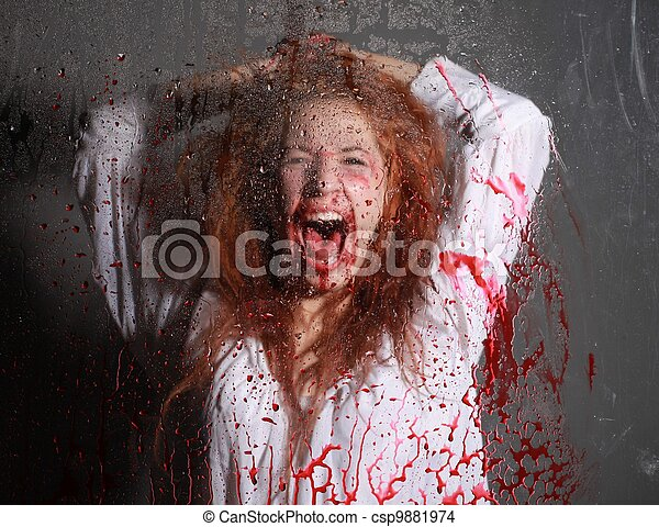 Horror Themed Image With Bleeding Frightened Woman - csp9881974