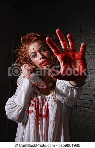 Horror Themed Image With Bleeding Frightened Woman - csp9881980