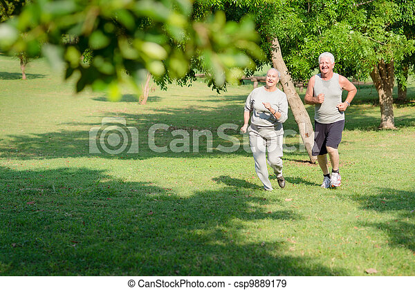 Active senior people jogging in city park - csp9889179