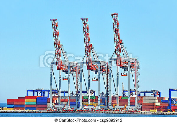 Port cargo crane and container over blue sky background - csp9893912