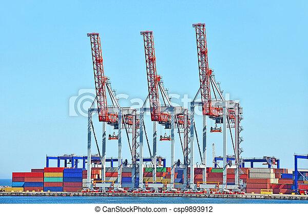 Port cargo crane and container over blue sky background - csp9893912