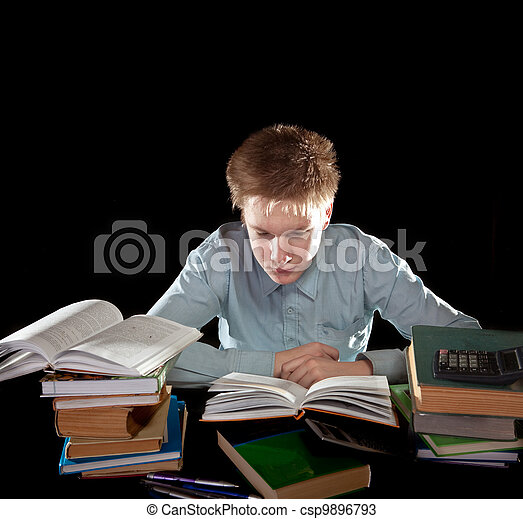 The teenager with a heap of textbooks - csp9896793