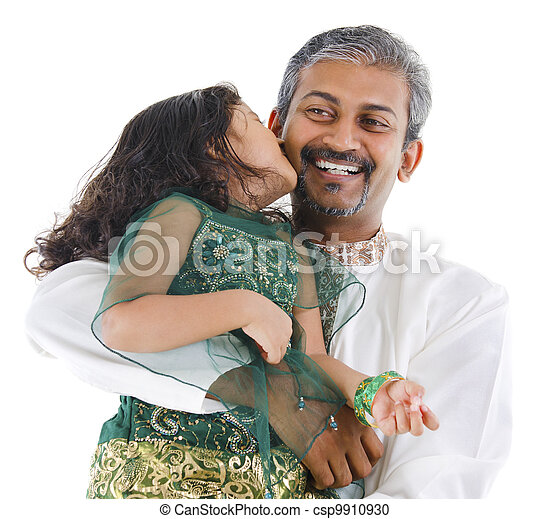 Happy Indian daughter kissing her father  - csp9910930