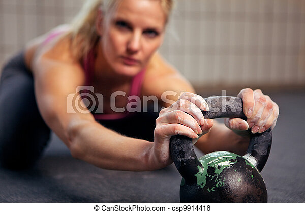 Woman Resting During Kettlebell Workout - csp9914418