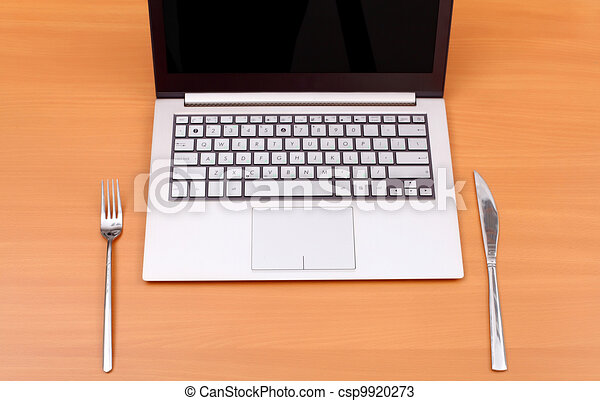 Laptop computer with fork and knife - csp9920273