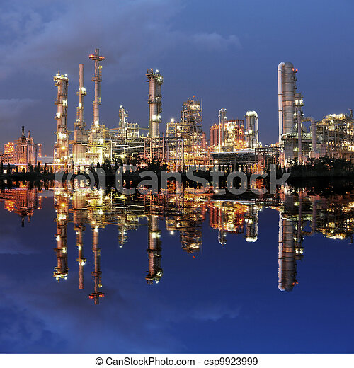 Reflection of petrochemical plant at night - csp9923999