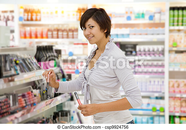 girl at cosmetics  shop - csp9924756
