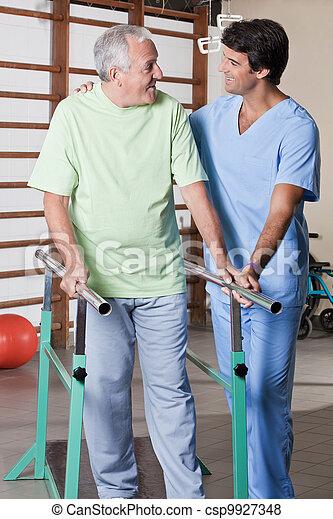 Senior Man having ambulatory therapy - csp9927348