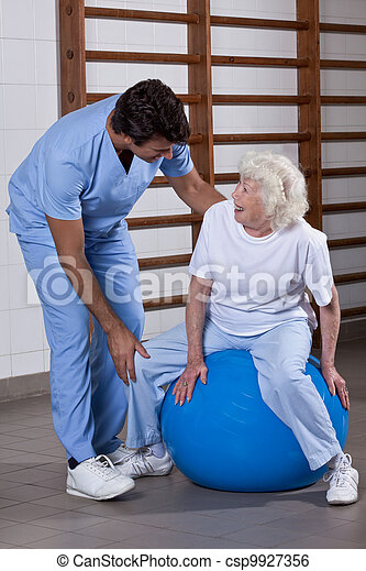 Physical Therapist helping a Patient - csp9927356