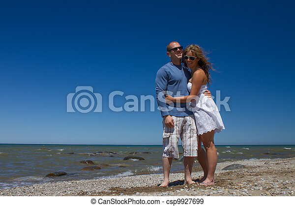 Women and Man relaxing on the Beach - csp9927699