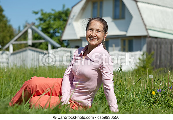 Happy mature woman against  residence - csp9930550