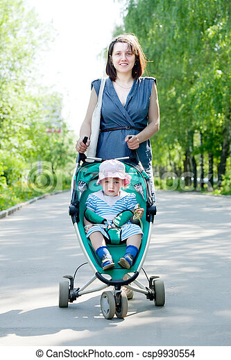 woman with stroller  at summer park - csp9930554