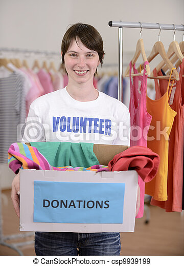 Volunteer with clothes donation box - csp9939199
