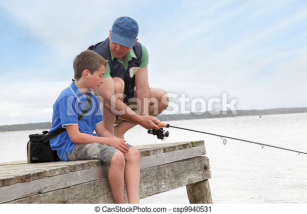 Father and son fishing in lake - csp9940531