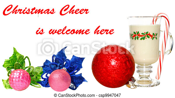 A cold glass of eggnog on white with a peppermint candy cane in it, a poinsettia flower and Christmas Balls with room for your text. - csp9947047