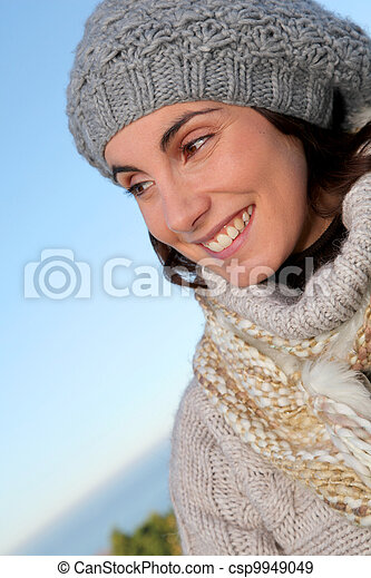 Portrait of beautiful smiling woman in winter - csp9949049