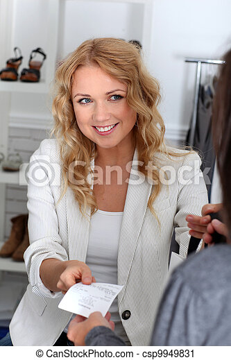 Customer in retail store paying with credit card - csp9949831