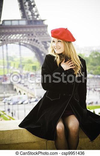 Female model red hat Eiffel tower - csp9951436