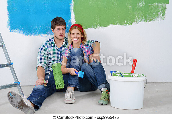 happy young couple relaxing after painting in new home - csp9955475