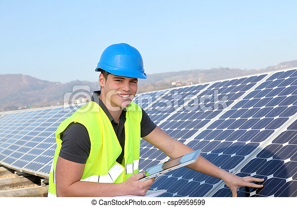 Young adult doing professional training on solar panels plant - csp9959599
