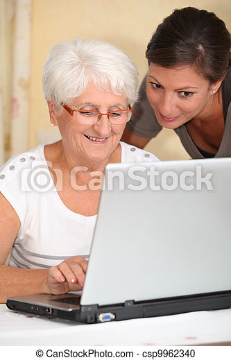 Stock Photography of Elderly woman learning how to use computer ...