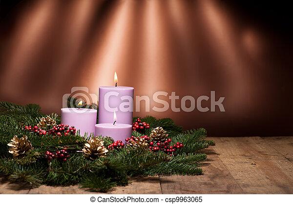 Three candles in an advent flower arrangement - csp9963065