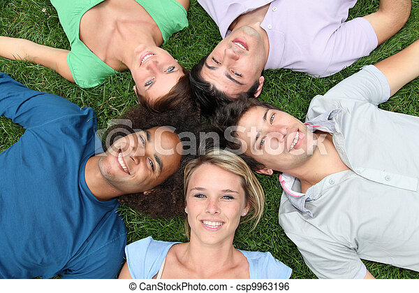 Group of friends laying down in park - csp9963196