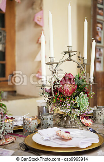 Wedding reception decor details, flowers and table centrepiece - csp9963914