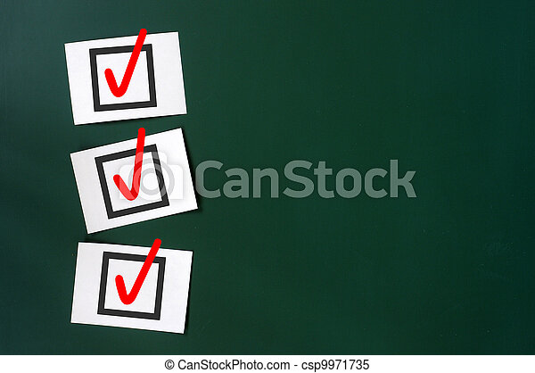Check box with red tick on a green chalkboard