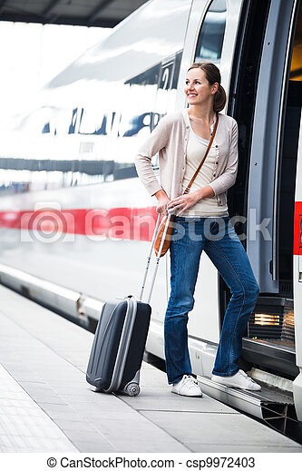 Pretty young woman boarding a train - csp9972403