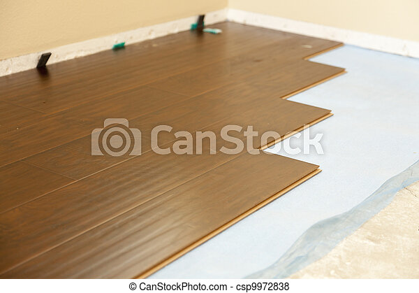 Newly Installed Brown Laminate Flooring - csp9972838
