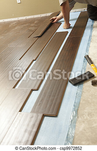 Man Installing New Laminate Wood Flooring - csp9972852