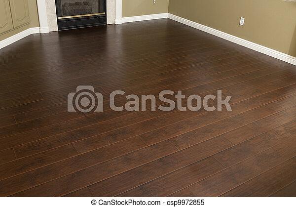 stock bilder von brauner fussboden laminat installed baseboards daheim csp9972855. Black Bedroom Furniture Sets. Home Design Ideas