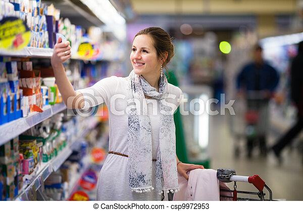 Beautiful young woman shopping for diary products  - csp9972953