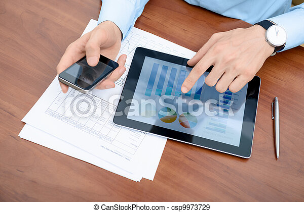 Man working with modern devices - csp9973729