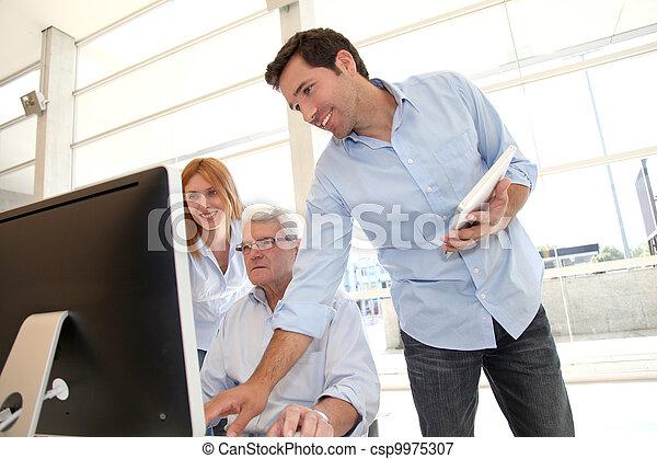 Senior people attending business training - csp9975307