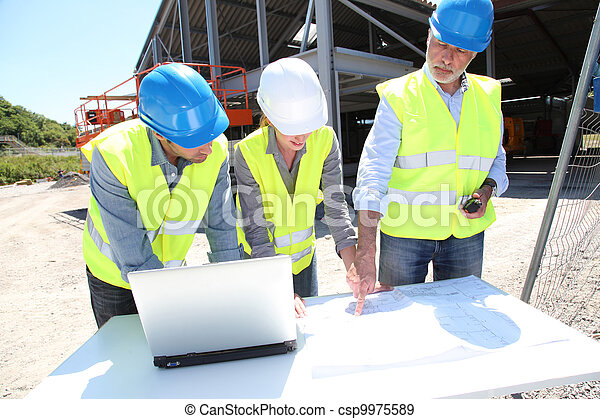 Industrial people working on building site - csp9975589
