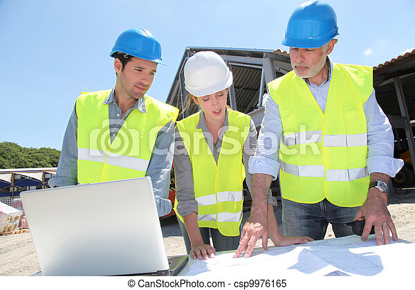 Industrial people working on building site - csp9976165