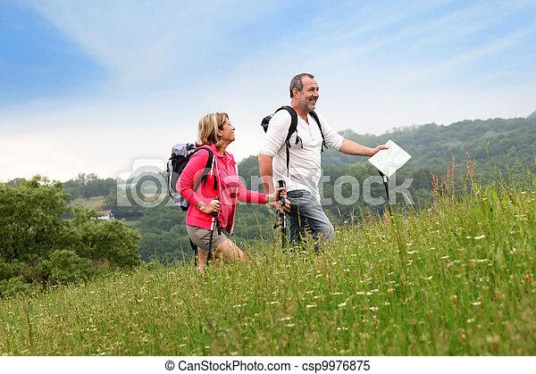 Senior couple hiking in natural landscape