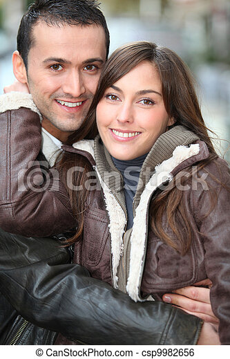 Young couple shopping in town in winter - csp9982656