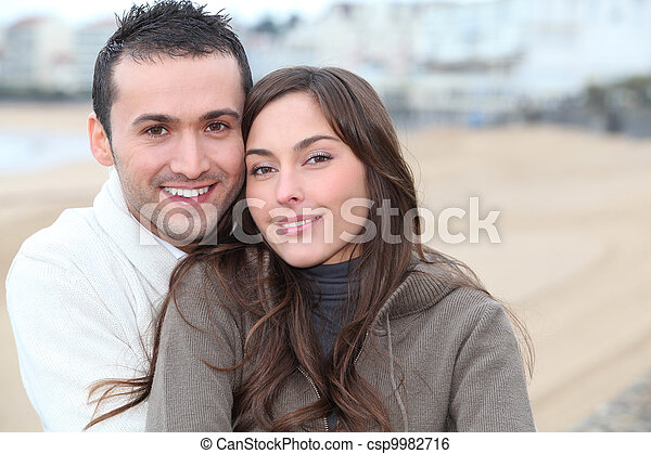 Young couple spending a week-end at the beach in winter - csp9982716