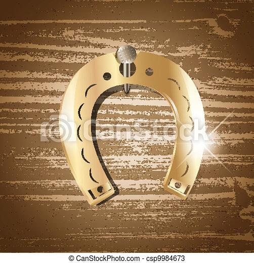horseshoe over wooden background - csp9984673