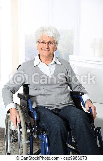 Elderly woman in wheelchair - csp9986073