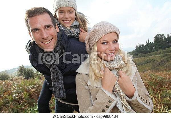 Closeup of happy family in fall season